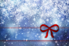 Xmas snowfall background with red ribbon Royalty Free Stock Image