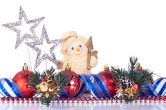 Xmas snowman toy. Snowman toy, xmas balls and silver stars isolated on white Royalty Free Stock Photos