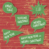 Xmas speech bubbles on wooden texture. Stock Image
