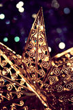 Xmas star. Close up of a golden xmas star Stock Photography
