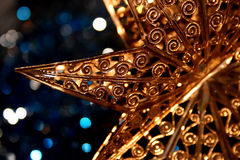 Xmas star. Close up of a golden x-mas star decoration Stock Images