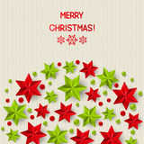 Xmas starry decorations on knitted background Royalty Free Stock Photo