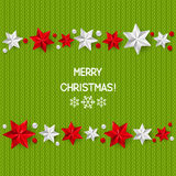 Xmas starry decorations on knitted background Royalty Free Stock Photos