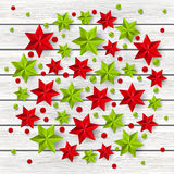 Xmas starry decorations on light wood Royalty Free Stock Photo