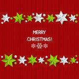 Xmas starry decorations on red knitted background Stock Photography