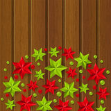 Xmas starry decorations on wood Royalty Free Stock Image
