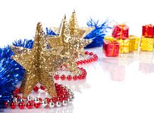 Xmas stars. Golden stars, ribbons, and gift in background Stock Image