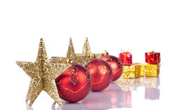 Xmas stars and balls in line. Xmas stars in line, between them red xmas balls Stock Image