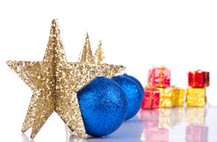Xmas stars with reflection. Golden stars in line with blue xmas balls on white Stock Photo