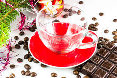 Xmas still life empty glass cup, coffee beans, chocolate, christmas tree and balls Stock Photography