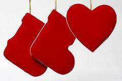 Xmas stockings and love heart. Two red Christmas stockings and love heart, isolated on white background Stock Photo