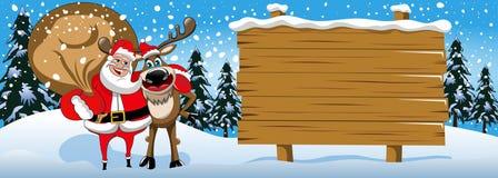 Xmas sztandar uwypukla Święty Mikołaj przytulenia reniferowego drewnianego szyldowego śnieg Zdjęcia Stock
