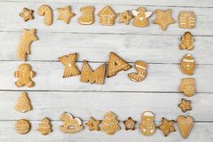 Xmas. Table top shot of a frame made of nicely decorated gingerbread cookies with Xmas written within the frame royalty free stock photos