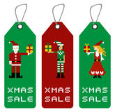 Xmas tag with pixel characters Stock Photography