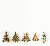 Xmas theme. Woman Jewelry. Vintage jewelry background. Beautiful bright rhinestone christmas tree brooches on white background. Flat lay, top view with copy Royalty Free Stock Image