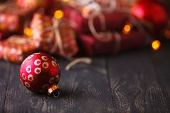 Xmas time. one christmas ball in front of a bunch of presents on Royalty Free Stock Photo
