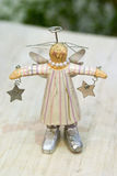 XMas Toys. Christmas toys, wood angel with stars Royalty Free Stock Images