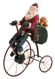 XMas Toys. Santa Claus on bicycle with bag Royalty Free Stock Image