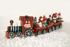 Xmas Train. Frosty puppet on white background traveling with a train Royalty Free Stock Photos