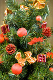 Xmas tree. Christmas tree decorated with red balls and gifts stock photography