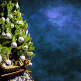Xmas tree. Christmas tree with decorations on grungy blue background Royalty Free Stock Image