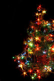 Xmas tree. With many colored lights on the black backgorund royalty free stock images