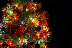 Xmas tree. With many colored lights on the black backgorund stock photos
