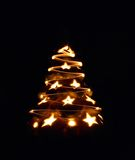 Xmas tree. From the stars on the black background royalty free stock photo