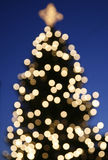 Xmas tree. Urban Christmas tree with blurred lights at dusk Royalty Free Stock Images