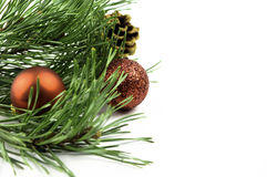 Xmas Tree with Baubles and Fir Cone. Close up of fir tree with fir cone and baubles Royalty Free Stock Photography