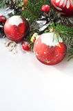 Xmas tree and baubles on the snow. Bright christmas baubles and xmas tree on the snow Royalty Free Stock Images