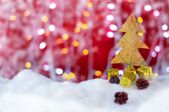 Xmas tree concept made by leaf with red background Royalty Free Stock Photo