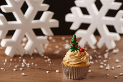 Xmas tree cupcake on Christmas background Stock Photo