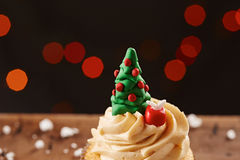 Xmas tree cupcake on Christmas background Royalty Free Stock Images
