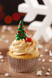 Xmas tree cupcake on Christmas background Royalty Free Stock Photography