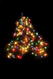 Xmas tree in the dark night Stock Images
