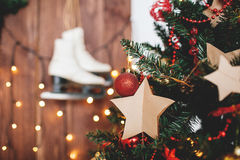 Xmas tree decorated over wooden background with lights and skate Royalty Free Stock Images