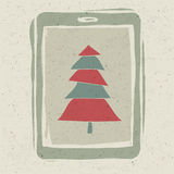 Xmas tree on tablet device screen Stock Photo