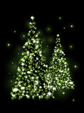 Xmas trees. Xmas light - green glowing trees Royalty Free Stock Images