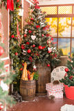 Xmas vintage interior with tree, wood, boxes and toys Royalty Free Stock Images