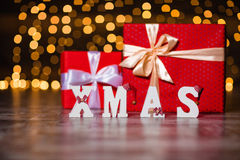 Xmas white decorated text and present boxes Royalty Free Stock Photography