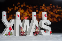 XMAS in white letter with blurred light background Stock Image