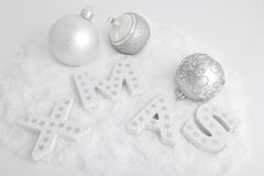 XMAS, white wooden letters and christmas balls Royalty Free Stock Images