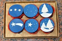Xmas winter night cupcakes Stock Image