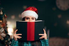 Girl Wearing Santa Hat Reading Story Tale Book stock image
