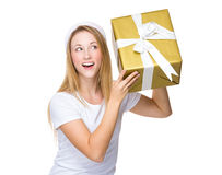 Xmas woman guess the present in box Royalty Free Stock Image