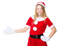 Xmas woman with hand show with blank sign Stock Photo