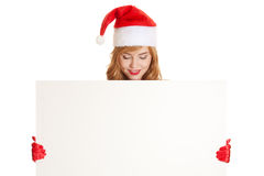 Xmas woman hoding blank sign billboard Royalty Free Stock Photos