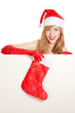 Xmas woman holding christmas stocking Stock Image