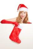 Xmas woman holding christmas stocking Stock Image